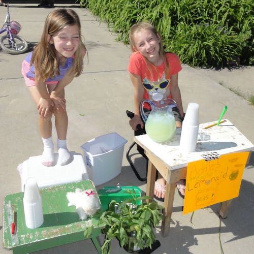 My girls—they raised over $50 in one afternoon to help save endangered species.